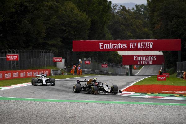 Kevin Magnussen, Haas VF-19, leads Lewis Hamilton, Mercedes AMG F1 W10