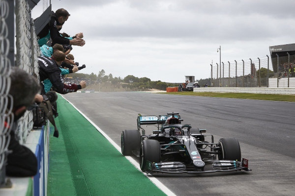 Lewis Hamilton, Mercedes F1 W11 EQ Performance, is greeted by team members as he takes the finish to score a record-breaking 92nd Formula 1 victory