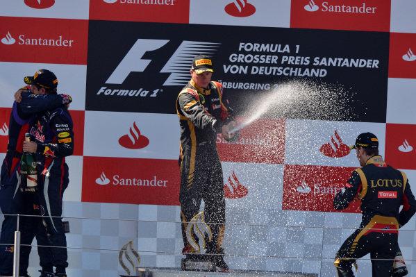 (L to R): Kimi Raikkonen (FIN) Lotus F1, Sebastian Vettel (GER) Red Bull Racing and Romain Grosjean (FRA) Lotus F1 celebrate on the podium. Formula One World Championship, Rd9, German Grand Prix, Race Day, Nurburgring, Germany, Sunday 7 July 2013.