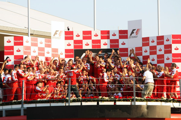 Ferrari celebrate a win for Fernando Alonso (ESP) Ferrari on the podium. Formula One World Championship, Rd 14, Italian Grand Prix, Race, Monza, Italy, Sunday 12 September 2010.