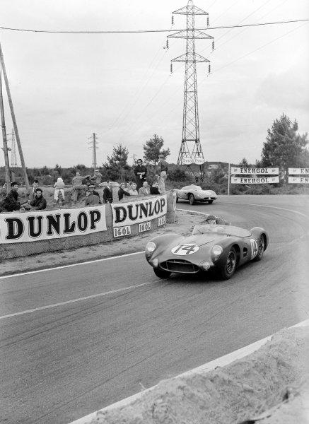 Le Mans, France. 28-29 July 1956.Tony Brooks/Reg Parnell (Aston Martin DBR1) leads Gerard Laureau/Paul Armagnac (DB HBR5-Panhard). Laureau/Armagnac finished in 10th position.Ref-Motor 773/25.World Copyright - LAT Photographic