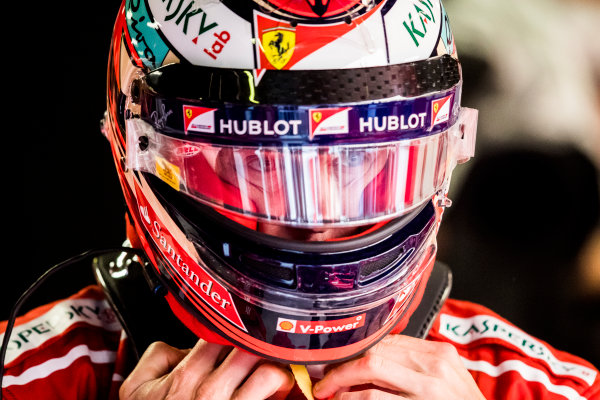 Autodromo Nazionale di Monza, Italy. Saturday 2 September 2017. Kimi Raikkonen, Ferrari, puts on his helmet. World Copyright: Sam Bloxham/LAT Images  ref: Digital Image _W6I3842