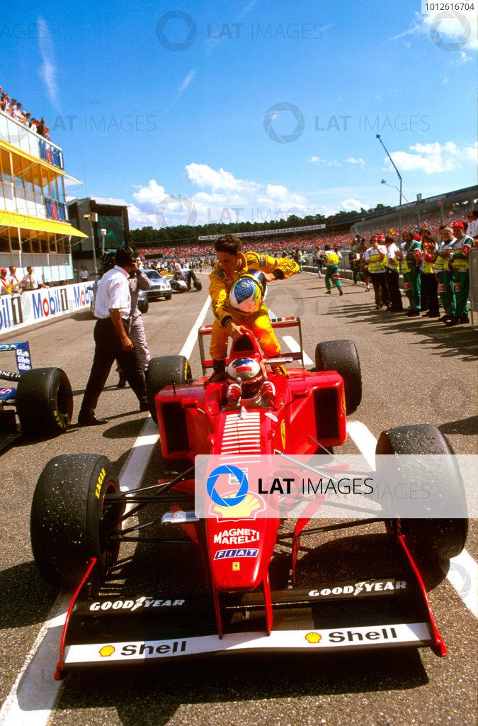 Hockenheim, Germany.25-27 July 1997.Michael Schumacher (Ferrari F310B) 2nd position, gives Giancarlo Fisichella a lift back to the pits aboard his car.Ref-97 GER 06.World Copyright - LAT Photographic