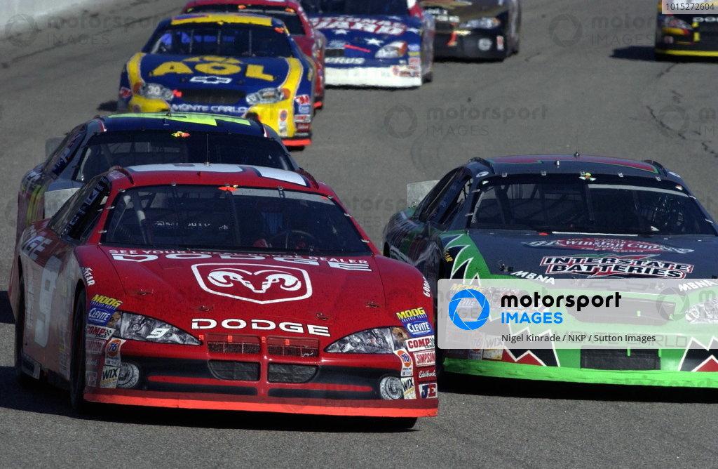 Race winner Bill Elliott (USA), Dodge Dealers, leads Bobby Labonte (USA), Interstate Batteries Chevrolet, who finished eighth. NASCAR Winston Cup Series, Rd35, Pop-Secret Microwave Popcorn 400, Rockingham, North Carolina, USA. 9 November 2003.DIGITAL IMAGE