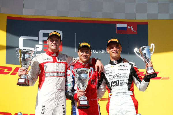2014 GP3 Series. Round 8.   Sochi Autodrom, Sochi, Russia. Sunday Race 2 Sunday 12 October 2014. Dean Stoneman (GBR, Marussia Manor Racing), Patric Niederhauser (SUI, Arden International) and Marvin Kirchhofer (GER, ART Grand Prix) celebrate on the podium. Photo: Glenn Dunbar/GP3 Series Media Service. ref: Digital Image _89P3052