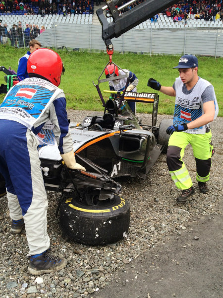 Red Bull Ring, Spielberg, Austria. Sunday 3 July 2016. Marshals remove the damaged car of Sergio Perez, Force India VJM09 Mercedes, after his last lap crash. World Copyright: Anthony Rowlinson/LAT Photographic ref: Digital Image IMG_3162
