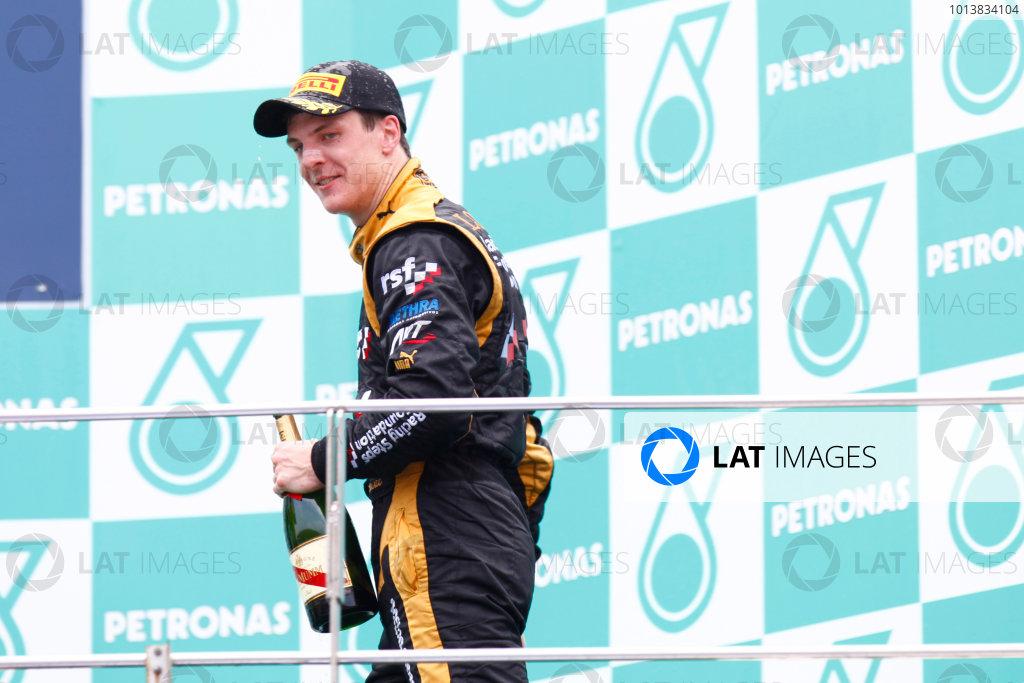 Sepang, Kuala Lumpur, Malaysia. 25th March 2012. Sunday Race.James Calado (GBR, Lotus GP) celebrates his victory on the podium. World Copyright: Alastair Staley/GP2 Series Media Service.Ref: Digital Image AS5D7701.jpg