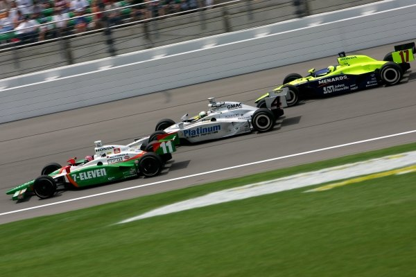 L-R: Tony Kanaan (BRA), Andretti Green Racing Dallara Honda, Tomas Scheckter (RSA) Panther Racing Dallara Chevrolet and Vitor Meira (BRA) Delphi Racing Panoz Honda, race for the lead in the Argent Mortgage 300.