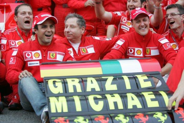 2006 Brazilian Grand Prix - Sunday Race Interlagos, Sao Paulo, Brazil. 19th - 22nd October 2006. The Ferrari team say goodbye to Michael Schumacher after the 7 times World Champion retires, portrait. World Copyright: Lorenzo Bellanca/LAT Photographic ref: Digital Image MU4Z4397