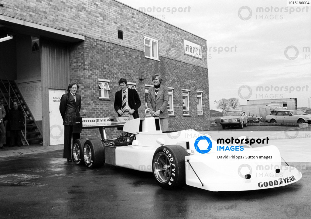 Robin Herd (GBR) March Designer (Centre) and Max Mosley (GBR) March Co-Owner (Right) with thieir new 6 wheeled creation, the March 2-4-0. Formula One World Championship, Bicester, Britain, c. November 1976.