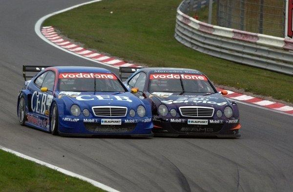 Fellow Dutchmen Patrick Huisman CEB AMG-Mercedes CLK , left, and Christijan Albers, Service 24h AMG-Mercedes CLK, right, collide.DTM Championship, Rd9, Zandvoort, Holland. 29 September 2002.DIGITAL IMAGE