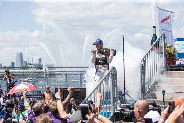 2016/2017 FIA Formula E Championship. Round 10 - New York City ePrix, Brooklyn, New York, USA. Sunday 16 July 2017. Winner Sam Bird (GBR), DS Virgin Racing, Spark-Citroen, Virgin DSV-02, celebrates on the podium as he sprays the champagne. Photo: Andrew Ferraro/LAT/Formula E ref: Digital Image _FER9949