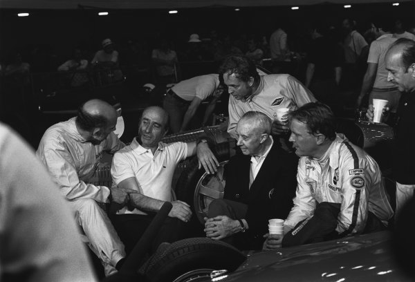 Long Beach, California, USA. 26 - 28 March 1976.L to R: Stirling Moss in conversation with Juan Manuel Fangio with on-lookers Rene Dreyfus, Phil Hill, Dan Gurney and Maurice Trintignant after the Historic support race, portrait. World Copyright:c Ref:  8413 - 16.