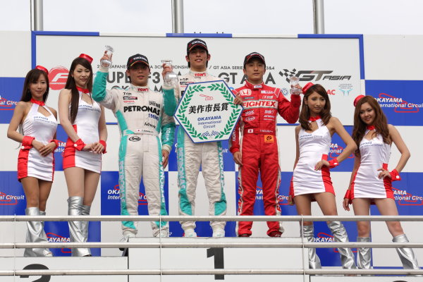 Okayama, Japan. 29th - 30th June 2013 Rd 3 Winner Yuichi Nakayama (Petronas Team TOM'S Spirit) on the podium with Takamoto Katsuta (Petronas Team TOM'S Spirit) and Katsumasa Chiyo (B-MAX Engineering). World Copyright: Yasushi Ishihara/LAT Photographic Ref: Digital Image 2013JF3_Rd7_005
