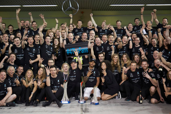 Yas Marina Circuit, Abu Dhabi, United Arab Emirates. Sunday 26 November 2017. Toto Wolff, Executive Director (Business), Mercedes AMG, Valtteri Bottas, Mercedes AMG, 1st Position, his wife Emelia, Lewis Hamilton, Mercedes AMG, 2nd Position, and the Mercedes team celebrate a great race result and another highly successful season. World Copyright: Steve Etherington/LAT Images  ref: Digital Image SNE13473