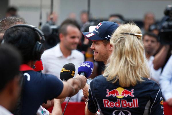 Buddh International Circuit, New Delhi, India. Saturday 26th October 2013. Sebastian Vettel, Red Bull Racing, is interviewed by the media World Copyright: Charles Coates/LAT Photographic. ref: Digital Image _N7T3685