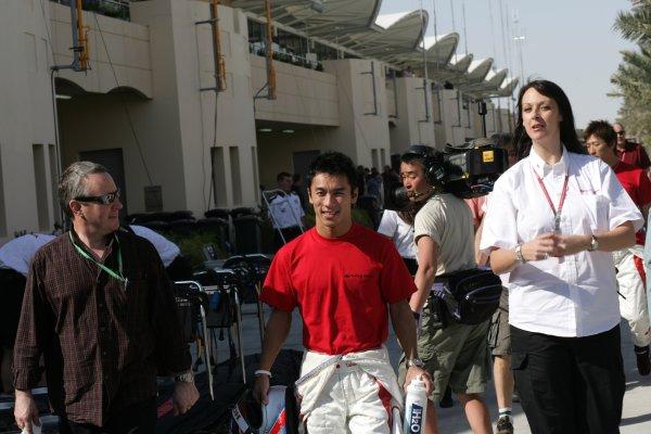 2006 Bahrain Grand Prix - Thursday Preview Bahrain International Circuit, Sakhir, Bahrain 9th - 12th March. Takuma Sato, Super Aguri SA05 with press officer Emma Bearpark (right), portrait. World Copyright: Steven Tee/LAT Photographic ref: Digital Image VY9E0120.