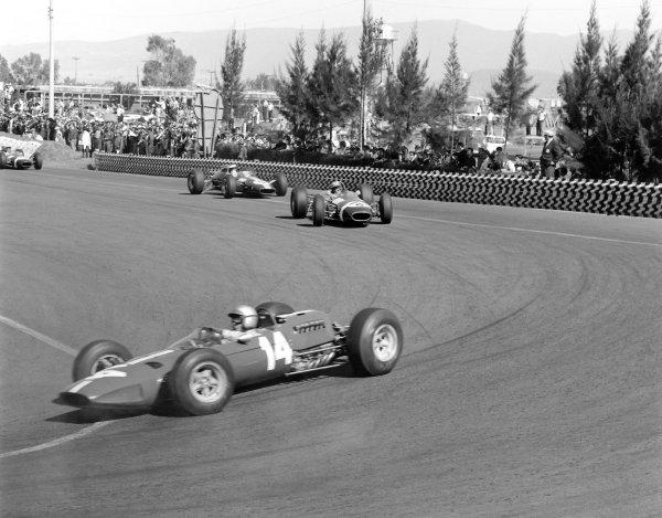 1965 Mexican Grand Prix.Mexico City, Mexico. 24 October 1965.Pedro Rodriguez (Ferrari 1512) leads Jo Siffert (Brabham BT11-BRM) and Jim Clark (Lotus 33-Climax).World Copyright: LAT PhotographicRef: 31713