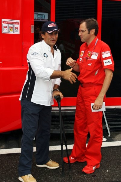 Alex Zanardi (ITA) WTCC Driver with Stefano Domenicali (ITA) Ferrari Manager of F1 Operations (Right).