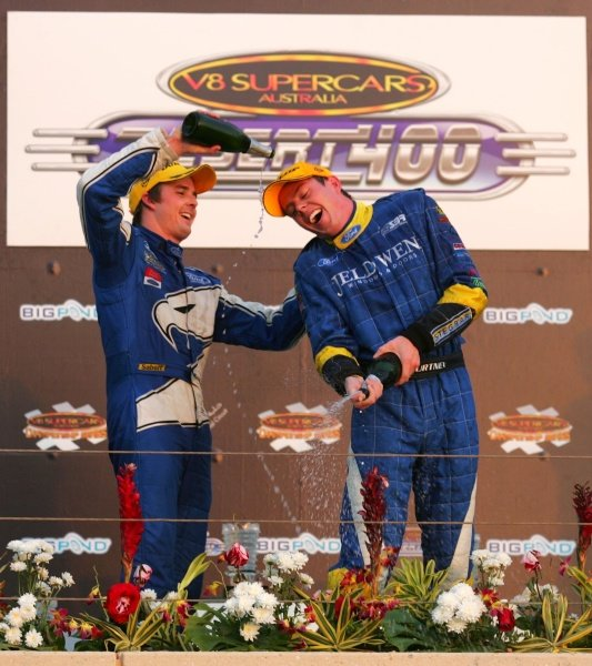 James Courtney (AUS) and Mark Winterbottom (AUS) winner on the podium. 
