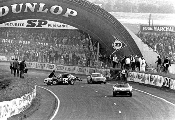 Le Mans, France. 20th - 21st June 1964.Ben Pon/Henk van Zalinge (Porsche 904 GTS), 8th position, passes the crashed Bob Tullius/Mike Rothschild (Triumph Spitfire), retired, action. World Copyright: LAT Photographic.Ref: B/W Print.