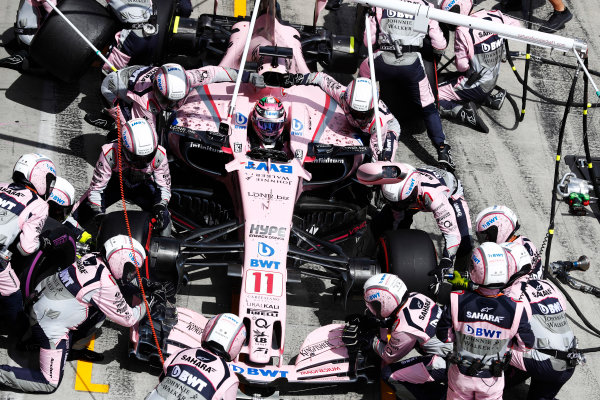 Red Bull Ring, Spielberg, Austria. Sunday 09 July 2017. Sergio Perez, Force India VJM10 Mercedes, makes a pit stop. World Copyright: Glenn Dunbar/LAT Images ref: Digital Image _X4I9371