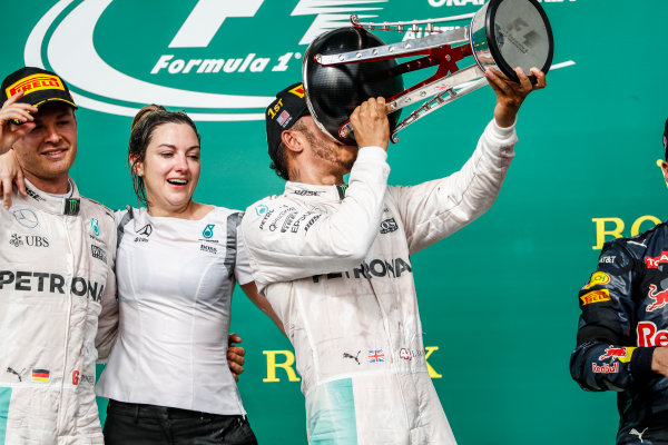 Circuit of the Americas, Austin Texas, USA. Sunday 23 October 2016. Lewis Hamilton, Mercedes AMG, 1st Position, drinks from his trophy. World Copyright: Glenn Dunbar/LAT Photographic ref: Digital Image _31I5253