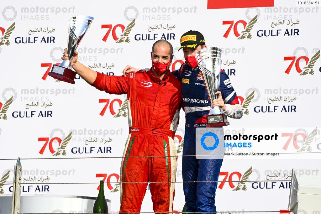 Winning Constructor Representative and Race Winner Robert Shwartzman (RUS, PREMA RACING) celebrate on the podium with the trophy