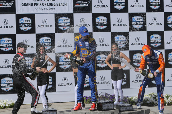 Celebrate with champagne on the podium