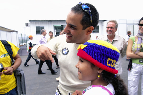 Juan Pablo Montoya poses with a young fan.