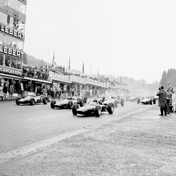 1963 Belgian Grand Prix.Spa-Francorchamps, Belgium.7-9 June 1963.Graham Hill (BRM P57), Dan Gurney (Brabham BT7 Climax) and Willy Mairesse (Ferrari 156) lead at the start.Ref-19184.World Copyright - LAT Photographic