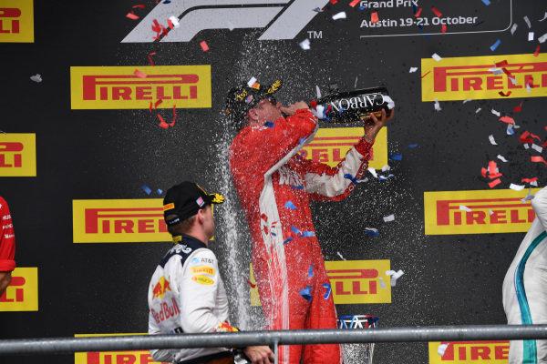 Max Verstappen, Red Bull Racing, Kimi Raikkonen, Ferrari and Lewis Hamilton, Mercedes AMG F1 celebrate on the podium with the champagne