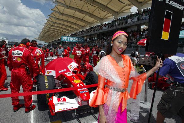 2003 Malaysian Grand Prix. Sepang, Kuala Lumpur, Malaysia.21-23 March 2003.Michael Schumacher (Ferrari F2002) on the grid before the start.World Copyright - Steve Etherington/LAT Photographic ref: Digital Image Only