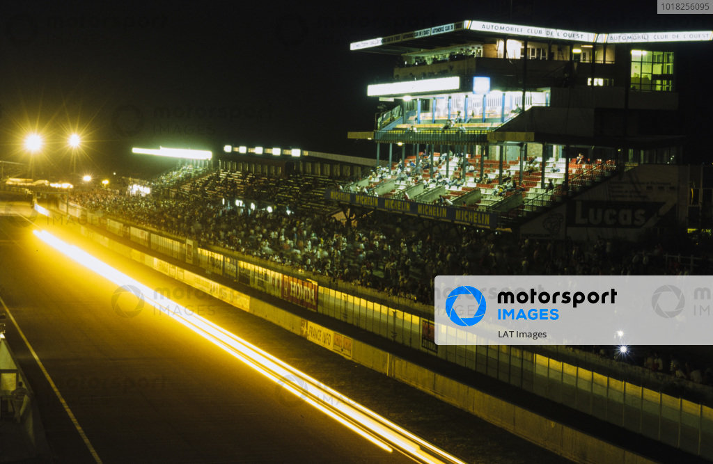 Light trails past the main grandstand.
