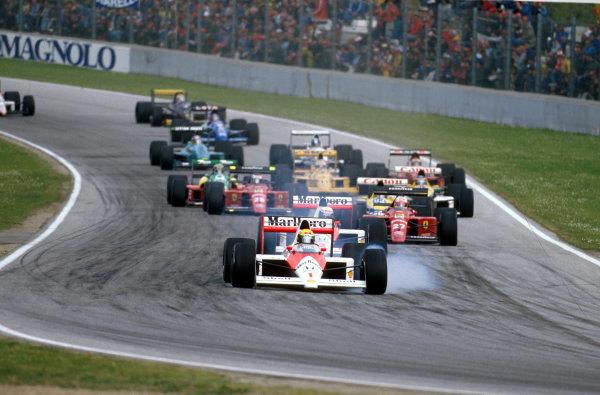 Imola, Italy. 21-23 April 1989.Ayrton Senna (McLaren MP4/5 Honda) locks up at Tosa whilst leading the field. Ref-89 SM 07.World Copyright - LAT Photographic