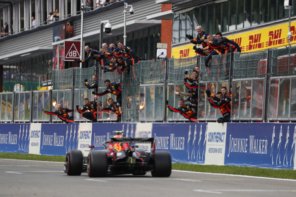 Alexander Albon, Red Bull RB15, is congratulated at the finish by his team