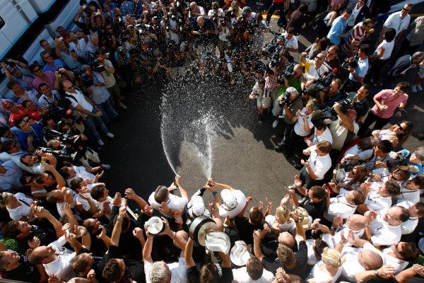 Autodromo Nazionale di Monza, Monza, Italy. 13th September 2009. Rubens Barrichello, Brawn GP BGP001 Mercedes, 1st position, celebrates with the Brawn GP team. Portrait. World Copyright: Andrew Ferraro/LAT Photographic ref: Digital Image _H0Y4788