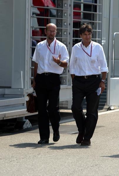 (L to R): Norman Howell (GBR) Formula One Management Pasquale Lattuneddu (FRA) Formula One Management. Formula One World Championship, Rd12, German Grand Prix, Preparations, Hockenheim, Germany, 31 July 2003. DIGITAL IMAGE