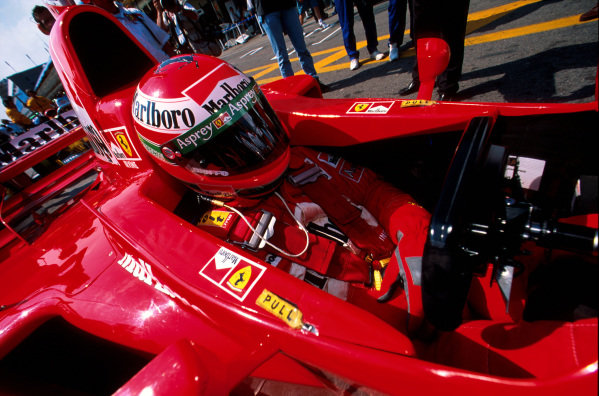 Interlagos, Brazil.28-30 March 1997.Eddie Irvine sits in the cockpit of his Ferrari F310B. He finished in 16th position.Ref-97 BRA 02.World Copyright - LAT Photographic