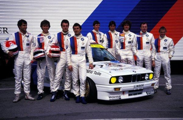 BMW M Team drivers (L-R) Emanuelle Pirro (ITA), Roberto Ravaglia (ITA), Roland Ratzenberger (AUT), Ivan Capelli (ITA), Markus Oestreich (GER), Altfrid Heger (GER), Christian Danner (GER), another driver, Winfried Vogt (GER).World Touring Car Championship, Rd1, Monza, Italy. 22 March 1987.