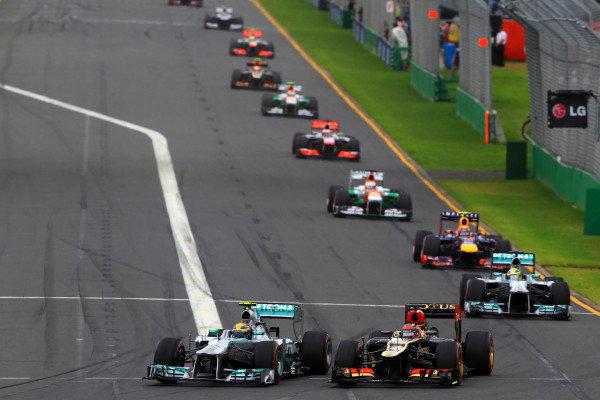 Lewis Hamilton (GBR) Mercedes F1 W04 battles with Kimi Raikkonen (FIN) Lotus E21. Formula One World Championship, Rd1, Australian Grand Prix, Race, Albert Park, Melbourne, Australia, Sunday 17 March 2013.  BEST IMAGE