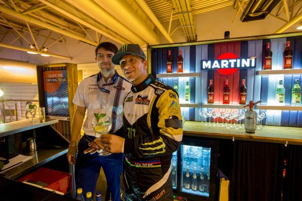 Autosport International Exhibition.  National Exhibition Centre, Birmingham, UK. Sunday 17 January 2016.  Petter Solberg learns how to mix Martini cocktails on the Williams motorhome. World Copyright: Zak Mauger/LAT Photographic. ref: Digital Image _L0U9434