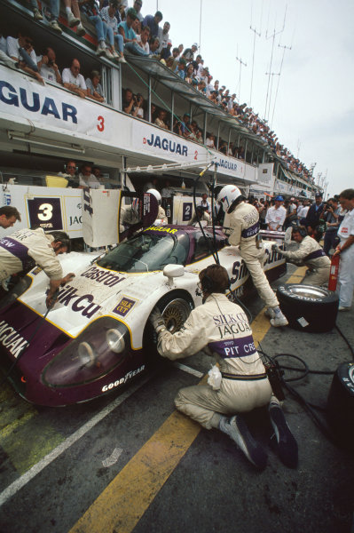 1990 Le Mans 24 Hours Le Mans, France. 16th - 17th June 1990. Martin Brundle/John Nielsen/Price Cobb/Eliseo Salazar (Jaguar XJR12), 1st position, pit stop and driver change, action. World Copyright: LAT Photographic Ref: 90LM31.