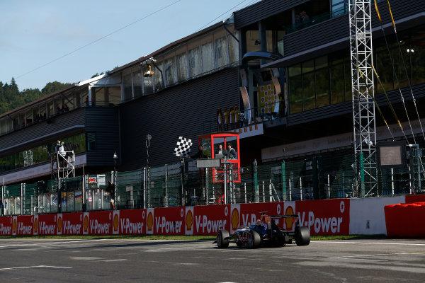 2014 GP3 Series Round 6. Spa-Francorchamps, Spa, Belgium. Sunday 24 August 2014. Alex Lynn (GBR, Carlin), takes the chequered flag Photo: Sam Bloxham/GP3 Series Media Service. ref: Digital Image _SBL7025