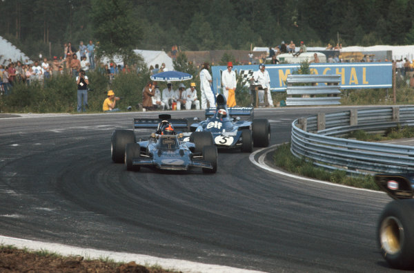 1973 Swedish Grand Prix.  Anderstorp, Sweden. 15-17th June 1973.  Emerson Fittipaldi, Lotus 72E Ford, 12th position, and Jackie Stewart, Tyrrell 006 Ford, 5th position, battle for position behind Ronnie Peterson, Lotus 72E Ford, 2nd position.  Ref: 73SWE34. World Copyright: LAT Photographic
