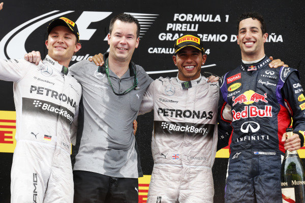 Circuit de Catalunya, Barcelona, Spain. Sunday 11 May 2014. Nico Rosberg, Mercedes AMG, 2nd Position, Mike Elliot, Head of Aerodynamics, Mercedes AMG, Lewis Hamilton, Mercedes AMG, 1st Position, and Daniel Ricciardo, Red Bull Racing, 3rd Position, on the podium. World Copyright: Alastair Staley/LAT Photographic. ref: Digital Image _79P1872