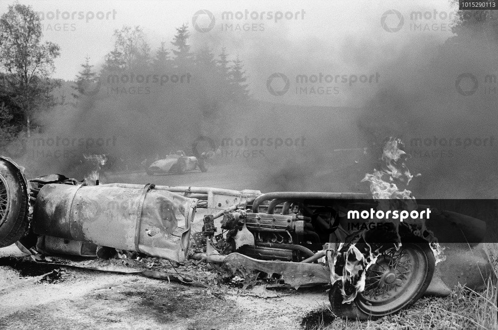 The burning wreck of Willy Mairesse's Ferrari 156.