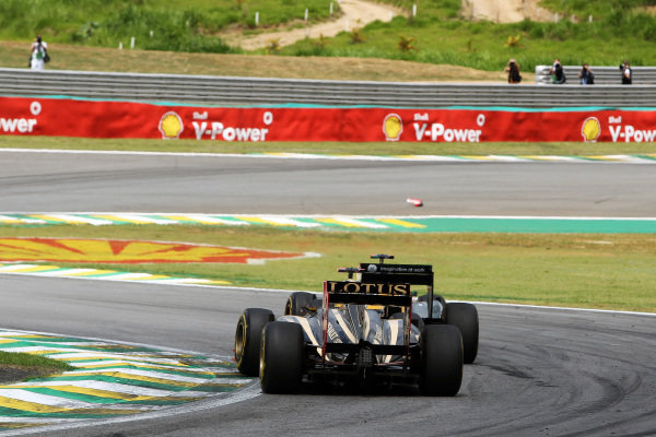 Bruno Senna (BRA) Lotus Renault GP R31 and Heikki Kovalainen (FIN) Team Lotus T128.