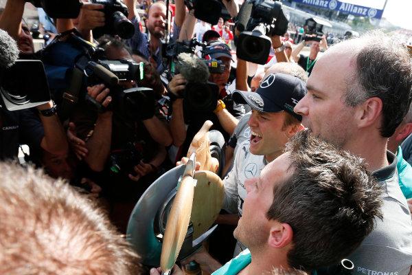Red Bull Ring, Spielberg, Austria. Sunday 22 June 2014. Nico Rosberg, Mercedes AMG, 1st Position, celebrates with his team. World Copyright: Sam Bloxham/LAT Photographic. ref: Digital Image _SBL0597