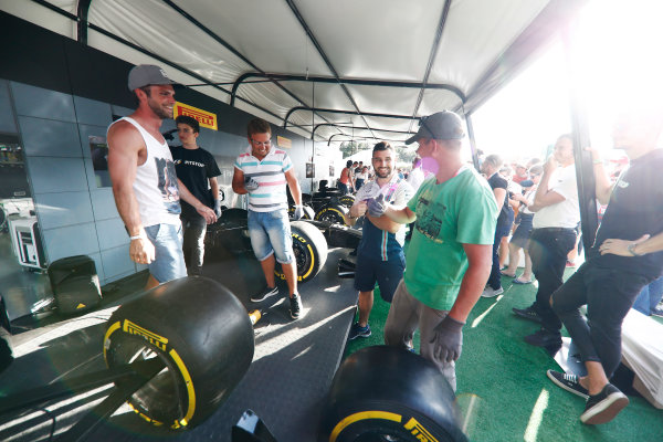 Red Bull Ring, Spielberg, Austria. Saturday 08 July 2017. Fans take part in the Pit Stop Challenge in the F1 fan village. World Copyright: Glenn Dunbar/LAT Images ref: Digital Image _X4I8269